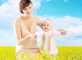 Charming mother hugging little daughter — Stock Photo