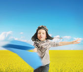 Little boy playing the paper plane — Stock Photo