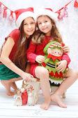 Portrait of two santa sisters — Stock Photo