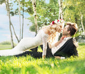 Marriage couple lying on the lawn — Stock Photo