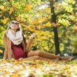 Smart lady watching autumn leaves — Foto Stock #59234015