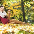 Beautiful pregnant lady on the golden ground — Stock Photo #59234043