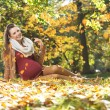 Art picture of pregnant lady under the leaves rain — Stock Photo #59234315