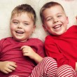 Two lying and laughing boys — Stock Photo #59239121