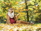 Smart lady watching autumn leaves — Stock Photo