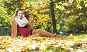 Beautiful pregnant lady on the golden ground — Stock Photo