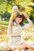Smiling woman with laughing baby — Stock Photo