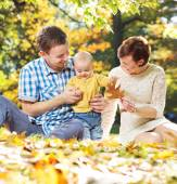 Young parents playing with baby — Stock Photo