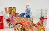 Portrait of a small boy on the huge gift — Stock Photo