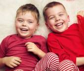 Two lying and laughing boys — Foto Stock