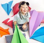Small cute boy with plenty toy planes — Stock Photo