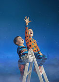 Two brothers collecting the stars — Stock Photo