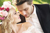 Delicate bride with handsome groom — Stock Photo