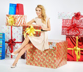 Alluring woman holding the Christmas box — Stock Photo