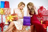 Two adorable women with Christmas gifts — Stock Photo