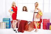 Three pretty women with empty board — Stock Photo