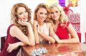 Three pretty women with huge present — Stock Photo