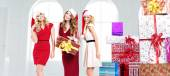 Alluring young women with gifts — Stock Photo