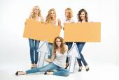 Five attractive women holding boards and arrows — Stock Photo