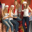 Four alluring girls promoting the Christmas — Stock Photo #60401405