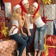 Three gorgeous women in Christmas mood — Stock Photo #60401613