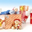 Little cute boy with plenty of gifts — Stock Photo #60402393
