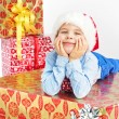 Charming little boy lying on present — Stock Photo #60402609