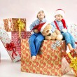 Two little brothers among presents — Stock Photo #60402771