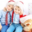 Two smiling little brothers among presents — Stock Photo #60403007
