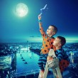 Two brothers holding the star — Stock Photo #60404759