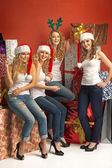 Four alluring girls promoting the Christmas — Stock Photo