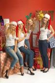 Cheerful girlfriends among huge presents — Stock Photo