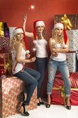 Three gorgeous women holding sparklers — Stock Photo