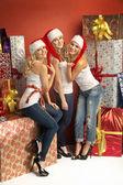 Three gorgeous women in Christmas mood — Stock Photo