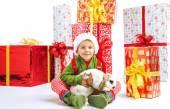 Cute little elf holding a rabbit — Stock Photo