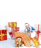 Little cute boy sitting on the gift — Stock Photo