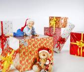 Charming little boy among the gifts — Stock Photo