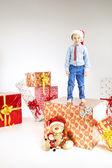 Little santa  standing on the gift — Stock Photo