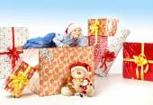 Little cute boy with plenty of gifts — Stock Photo