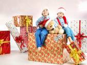 Two little brothers among presents — Stock Photo