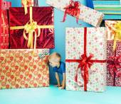 Little man looking for his gift — Stock Photo
