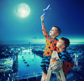 Two brothers holding the star — Stock Photo