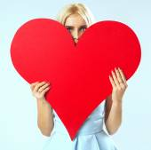 Portrait of the woman with a red heart — Stock Photo