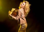 Blond alluring girl holding the gifts — Stock Photo