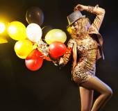 Partying girl with a bunch of balloons — Stock Photo
