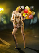 Blond alluring woman with balloons — Stock Photo