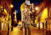 Young shapely girl heading for night club — Stock Photo
