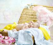 Adorable newborn child lying on soft blanket — Stock Photo