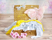 Colorful blankets in the wicker basket — Stock Photo