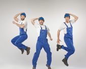 Portrait of three dancing builders — Stock Photo